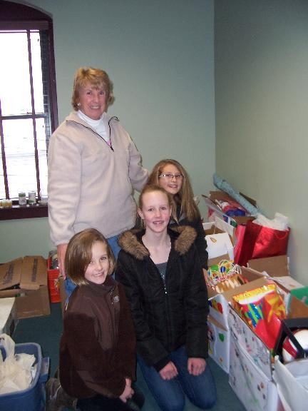 Girl Scouts donate birthay boxes